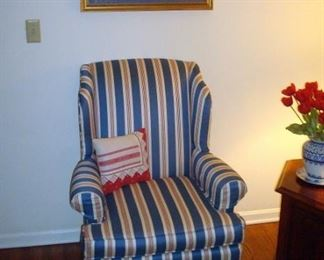 One of two wing back chairs and oil painting above.