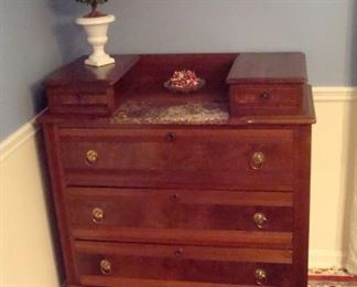 Victorian chest of drawers with marble insert and oil painting.