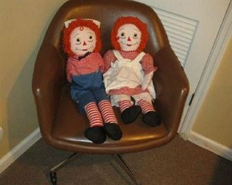 Chair and raggedy ann and Andy dolls