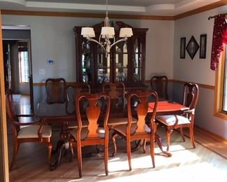 Table, extension leaf, padded cover and Chairs $500