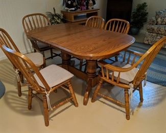 $150   Table with leaf and four chairs