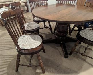 $100   Round, dark table with 6 chairs