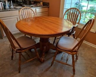 $275   Round, oak table with four chairs