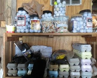 Dozens of golf balls and tees.