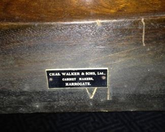 The very fine dining chairs have individual plaques stating the maker: Chas. Walker & Sons, Ltd. Cabinet Makers, Harrogate.