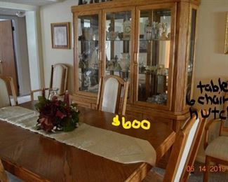 dining room set, 2 captains chairs, 4 chairs, 1 leaf, hutch sold as a set