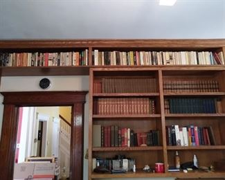 Nice library. Mixture of paperbacks to vintage leather bound.