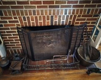 Early Americana hand forged cast iron fireplace accessories.