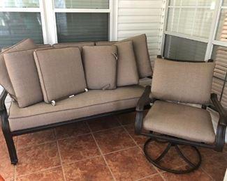 Outside metal sofa and swivel chair