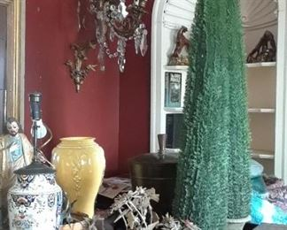 You will find various sizes of topiaries. You will never need to water these lovely plants. The niches in background will be for sale as will all architectural elements, light fixtures, tiles, wood flooring, banisters, molding, and the like. A great opportunity!
