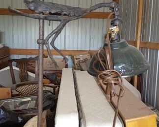 We believe this to be an old cast iron floor lamp where the heron adjusts the lamp up and down. Needs rewired.