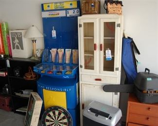 Lottery Booth,  vintage kitchen cabinet , chain saw,