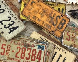 Assorted old license plates
