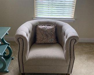 Neutral barrel back chair with nail head trim