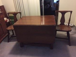 Abernathy Furniture Company dining room set. 85-90 years old, dark walnut.  Matching dining room table with 4 chairs.