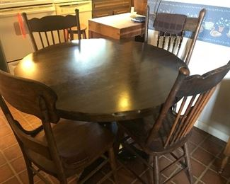 Dining room table and antique chairs