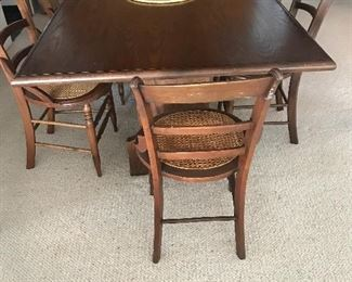 Hand crafted trestle table and 6 antique chairs