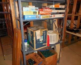 Jigsaw puzzles; Slide projector, table, screen, misc.