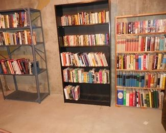 Books; wood bookshelves; metal shelf unit