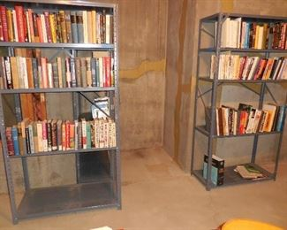 Books; metal shelving (there's a third shelf unit behind the one on the left)