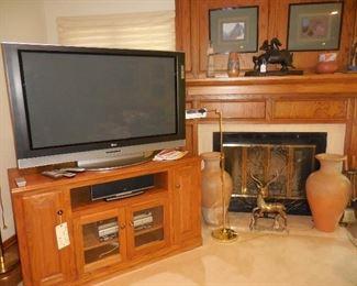 "50"" LG TV; LG sound system; TV cabinet; décor items"