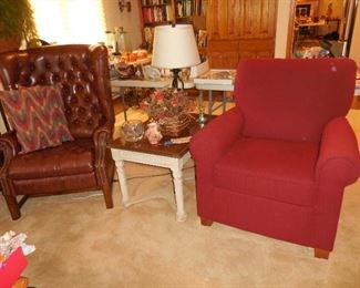 Leather wingback recliner (Barcalounger); red overstuffed chair; end table