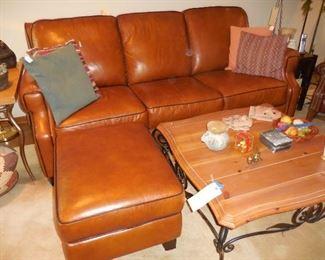 Beautiful leather sofa and matching ottoman