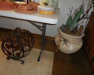 Wine rack; large pot with faux cactus