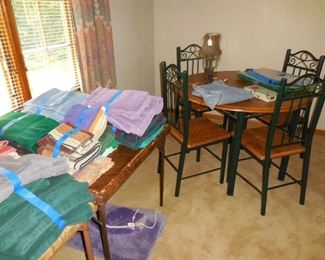 Small metal and wood table and chairs; bathroom linens