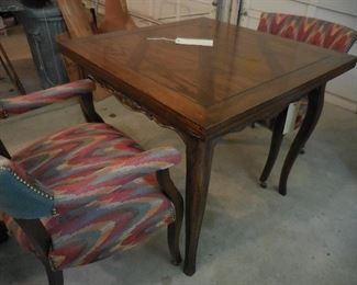 Table has top that folds out to double size; 2 of 4 chairs set