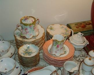 Many hand painted Haviland porcelain plates from the early 20th century