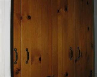 Knotty pine linen closet