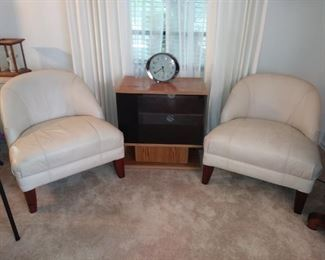 Leather side chairs and Retro clock and TV stand.