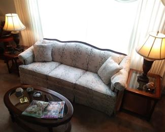 Two end tables, coffee table, couch and lamps.