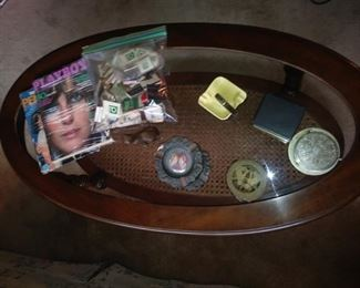 Vintage magazines and ashtrays, coasters.