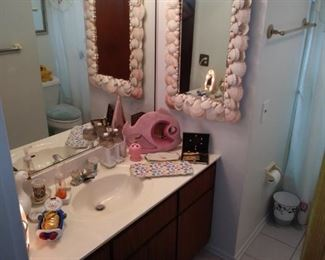 Shell mirror, Vintage fish sculpture and pedicure items.
