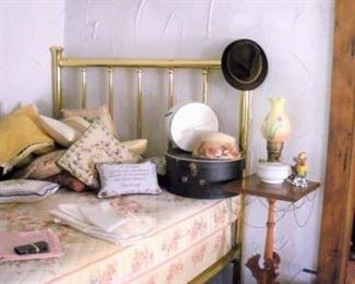 Working hard to get this house ready for you, but I think I'll take a nap before you arrive on this antique brass bed.