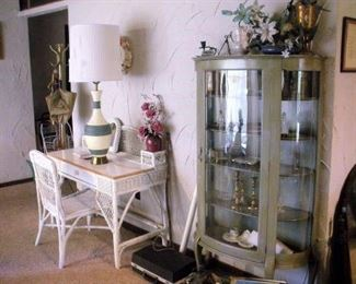 Just 1 of 2 antique curved glass china cabinets.  Lots of antique wicker furniture all throughout the house.