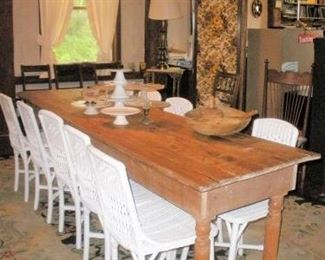Antique Harvest Table.....we recently found 2 more wicker chairs for a total of 12.