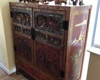 Early to mid-20th century Asian heavily carved, lacquered and decorated armoire
