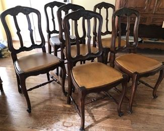 Early 20th century French dining chairs with leather upholstered seats