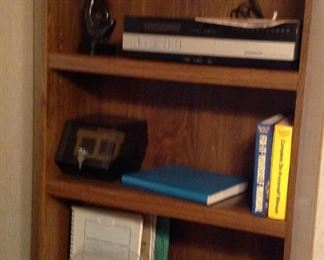 One of the bookcases, Magnavox video cassette player, books (including vintage Webster's dictionary) , flip n file,