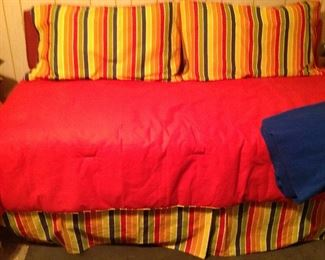 Nice twin size Day bed with bolster pillows and bedding, throw