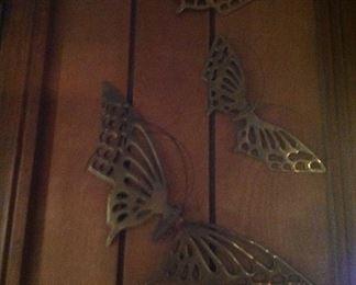 Set of brass butterflies