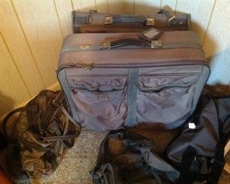 Set of grey luggage and other bags