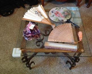 One of a pair of side table - glasss with iron base, vintage fans