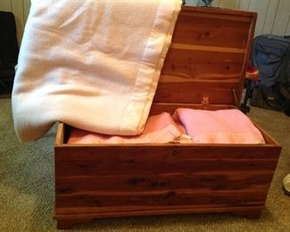 Vintage cedar chest full of vintage blankets