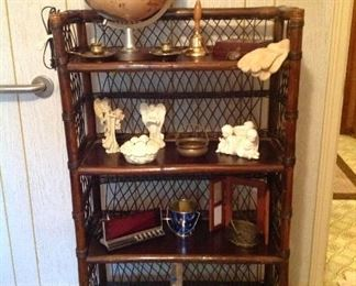 Rattan shelving unit, vintage globe, pair of brass candholders, angel collection brass baskets digital clock, picture frame, book, set of crouched hooks