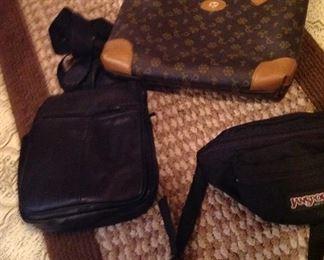Rug, purse, Jansport fanny pack and shoulder bag