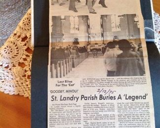 Newspaper clippings about the funeral for Sheriff Cat Doucet -1975 taped to the inside of the George Rodriquez book